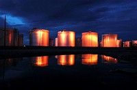 Refinery tanks reflected in water, Idaho, USA