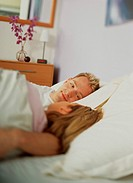Couple Lying in Bed Talking