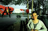 Young Woman Camping by Lake