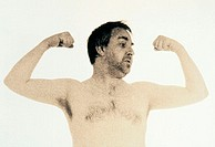 CREDIT: CRISTINA PEDRAZZINI/SCIENCE PHOTO LIBRARY Arm exercise. Man showing off his arm muscles.