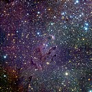 Young stars in the Eagle Nebula. Infrared image of the Eagle or M16 Nebula (lower left), showing hot young stars (red). The stars, at the edges of the...