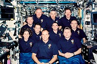ISS astronauts. Group portrait of the crew of the International Space Station (ISS) and Space Shuttle mission STS-110 in the Destiny Laboratory on the...