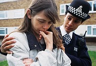 CREDIT: JIM VARNEY/SCIENCE PHOTO LIBRARY   Policewoman  comforting  unhappy woman.  Policewoman counselling an upset woman who has been affected by a ...