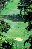 Golf player going home, St Andrew´s Golf Club, located in the hills to the north of Port of Spain. Trinidad. West Indies