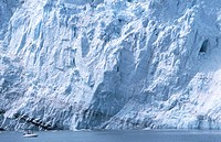 Face of Margerie Glacier, visitors in inflatable boat get close. Glacier Bay National Park. Alaska. USA