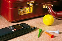 Briefcase, mobile phone, golf ball and tees