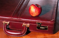 Apple and briefcase