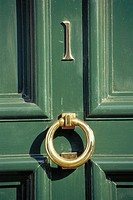 Numerb one and door knocker
