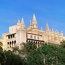 Almudaina Palace, former residence of the Arab dynasty, with the gothic cathedral in background. Palma de Mallorca. Majorca. Balearic Islands. Spain