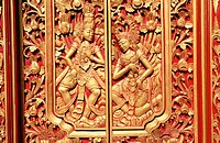 Wood carving reliefs on temple door. Kuta. Bali. Indonesia