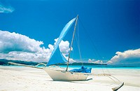 Boracay, outrigger sailboat on white sand beach. Philippines