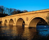 Old stone bridge across river Tweed, Coldstream, Scotland