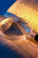 Magnifying glass on book (thumbnail)