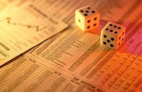Financial page and dice
