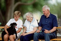 Grandparents with boy and dog