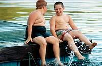 Boys enjoying splashing in a lake