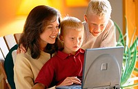 mom using laptop with her sons