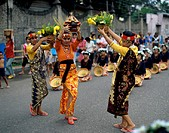 Three mid adult women dancing on a road, Sinulog Festival, Cebu, Philippines