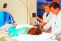 CT SCANNER<BR>Photo essay.<BR>Exploratory CAT scan of body. Sainte Anne Hospital in Paris, France.