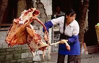 Lady butcher in Dali. Yunnan. China