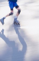 waist down view of a skater and shadow