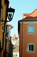 Street in Regensburg with medieval residential tower. Bavaria, Germany