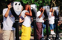 Tourists using binoculars at Hudson River promenade, Battery Park. Lower Manhattan, New York City. USA