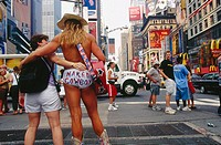 Naked cowboy street artist at Times Square. Manhattan, New York City. USA