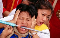 A female medium getting pierced during the Vegetarian Festival in Phuket. South Tahiland