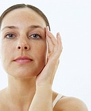Woman´s face. Woman feeling her face for signs of ageing.