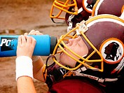 5 Year old boy drinking water at full contact football game