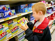 7 year old boy shopping in supermarket