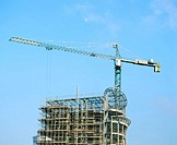 Construction crane and office block under construction