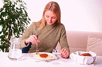 WOMAN EATING STARCHY FOOD<BR>Model.