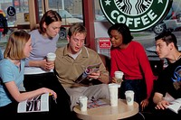 Teenagers socialize in a Starbucks after school.