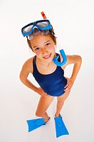 Young girl (10 years old) in swimsuit with mark, fins, and snorkel.