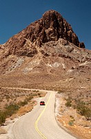 ´A car drives along Route 66 by Boundary Cone Mountain. Route 66 is a historic highway that is also known as ´´the main street of America´´. Oatman, A...