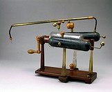 An electrotherapeutic machine invented by Edward Nairne (1780-1809). Turning the handle rotated the glass drum against a leather pad, thus producing a...