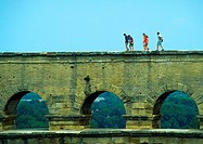 People walking over aqueduct