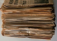 Pile of old newspaper, close-up