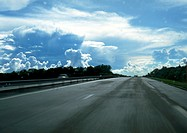 Straight road, cloudy sky