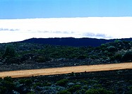Mountain road with clouds behind mountain