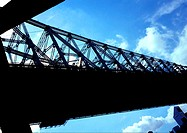 Bridge seen from angle, silhouetted against sky