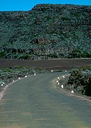 Curve in road through mountainous region