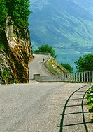 France, Savoie, Alpes, road curving around mountainside