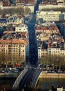 France, Lyon, bridge and city street