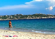 Corsica, people wading at beach