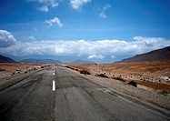 Chile, El Norte Grande, road through desert, low horizon, vanishing point