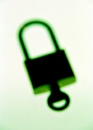 Padlock with key, blurred , close-up