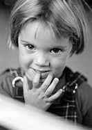 Little girl with finger in mouth, portrait, b&w